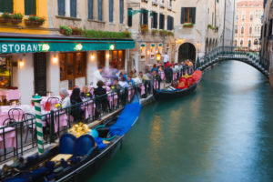 Outdoor Restaurant  and Gondolas beside Canal, Venice, Italy