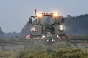 Harvest time, combine at twilight