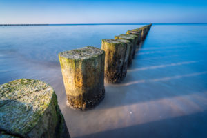 Breakwaters on the Baltic Sea in the evening light and long exposure