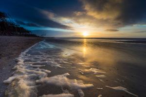 Baltic Sea at evening light and long exposure, setting sun