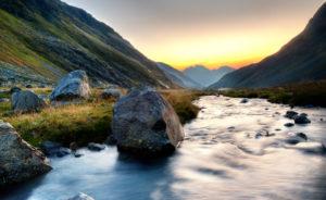 Creek with rocks direction Alpeiner Ferner above the Franz Senn hut, morning mood