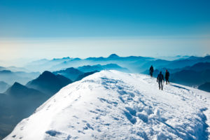3 mountaineers on the Vincent Pyramid, Monte Rosa, Italy