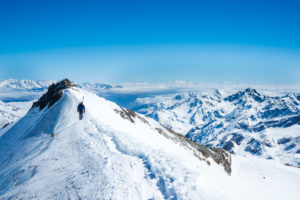 Skitourers on the summit Cevedale, Ortler Group, South Tyrol, Trentino, Italy,
