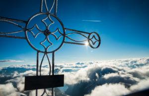 View from Oberaarhorn, summit cross, Bernese Alps, Switzerland