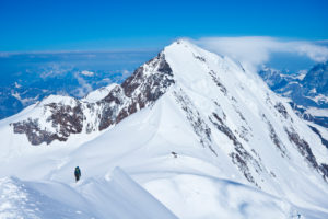 1 mountaineer on the summit ridge Ludwigshöhe, view to the Liskamm, Monte Rasa, Italy