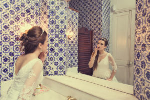 Bride in front of the bathroom mirror