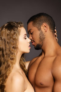 Standing couple, kissing, close-up
