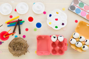 Dyeing and painting Easter eggs, watercolour, egg carton, eggs with moustache, nest, top view