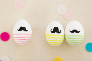 three Easter eggs with beard, colourful
