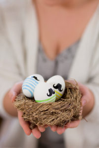 Woman, presenting Easter nest, Easter eggs with beard