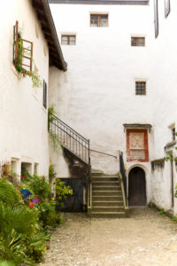 Inner courtyard, stairs, iron door, plants, facade