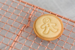 Christmas biscuit, cooling rack, gingerbread man, table