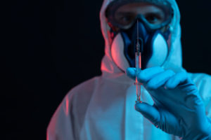 Symbol, corona, science, research, vaccine, danger, dystopian, protective suit, cut, show, syringe