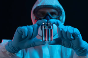Symbol, corona, science, research, vaccine, danger, dystopian, protective suit, two, injection vials