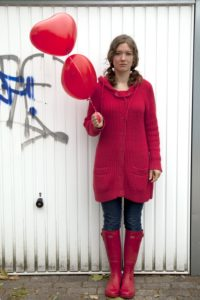 Woman, young, serious, balloons, heart shape, lovesickness,