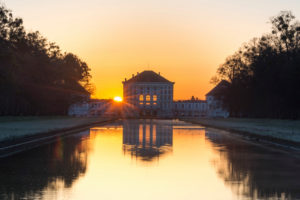 Germany, Bavaria, Mittelkanal with Nymphenburg Palace in the morning