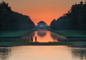 Germany, Bavaria, Nymphenburg Palace with park and sunrise