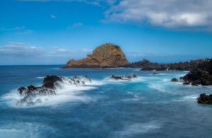 Atlantic Ocean at Porto Moniz with rock island Ilhéu Mole, Madeira, Portugal