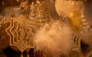 Christmas decorations, stars and feathers in gold