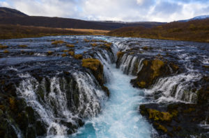 Iceland, waterfall in autumn, barren landscape