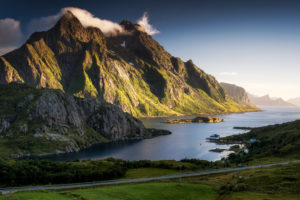 Norway, Lofoten, fjord with mountain in the evening light