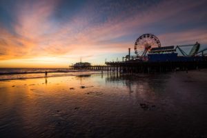 USA, California, Los Angeles, Santa Monica Pier, sunset on the beach