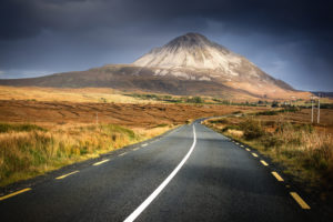 Ireland, Northern Ireland, Mount Errigal in the evening light, road through countryside