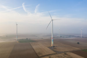 Wind farm with wind turbines, aerial view