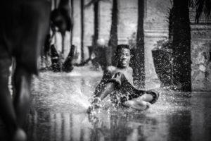 Cuba, Havanna, Cuba, Havanna, boy have fun in wet conditions