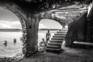 Cuba, Havanna, two young men in old building by the sea,