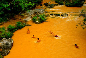 Cuba, Havanna, young people swim in the Yellow River,