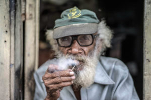 Cuba, Havanna, old man smoking a cigar, portrait