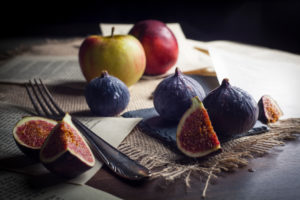 Figs and apples with old silver cutlery