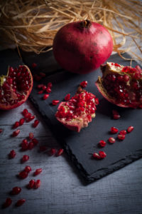 Pomegranate on slate plate