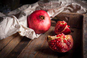 Pomegranate in wooden box