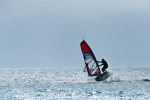 Windsurfer on the Walchensee in Bavaria, Germany.