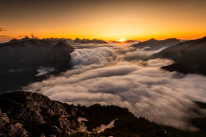 Sunset and the gathering of thick high fog over the Achensee in the Karwendel, seen from the Ebener Joch in the Rofan Mountains