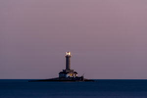 The Premantura lighthouse on the Istrian coast at nightfall.
