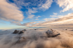 Sea of clouds over the Karwendel with the Laliderertal, Mahnkopf, Laliderer Falk, Rißer Falk, Gumpenspitze, Gamsjoch, Ruederkarspitze and Roßkopfspitze. Shot shortly after sunrise in late autumn from the Lalidererspitze.