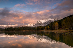 Autumn at Lautersee near Mittenwald, with the Karwendel, snow and sunset in the background