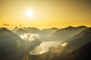 Golden sunset over the Achensee with light clouds on the Karwendel Mountains
