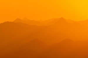 Golden light from sunrise over the Rofan mountains