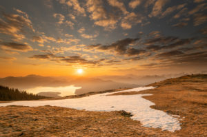 Spring sunrise at Simetsberg in the Ester Mountains, in the background the Walchensee and the Karwendel in the German and Austrian Alps