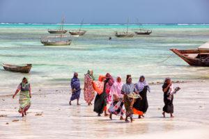 Locals having evening walk along south beaches of Zanzibar,