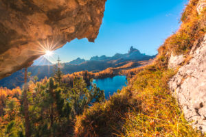 Federa lake in autumn framed in a rock window, Croda da Lago, Dolomites, Cortina d Ampezzo, Belluno, Veneto, Italy
