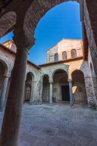 Porec, Parenzo, Euphrasian Basilica, arcades and tower view, unesco world heritage site, Istria, Adriatic coast, Croatia