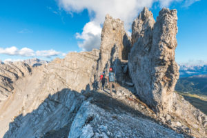 Two hikers on the Bepi Zac High Trail, Costabella Ridge, Marmolada group, Dolomites, Fassa Valley, Trento province, Trentino-Alto Adige, Italy