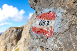 Footpath trail marker painted on a rock along the Bepi Zac High Trail, Costabella Ridge, Marmolada group, Dolomites, Fassa Valley, Trento province, Trentino-Alto Adige, Italy
