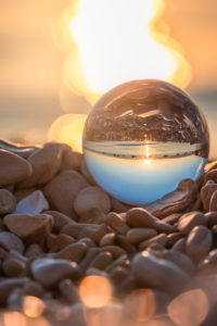 crystal ball on the pebble beach of Mošćenička Draga at sunrise, Primorje-Gorski Kotar County, Croatia