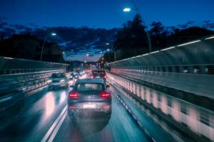 evening traffic of cars in the city, alpini bridge, belluno, veneto, italy